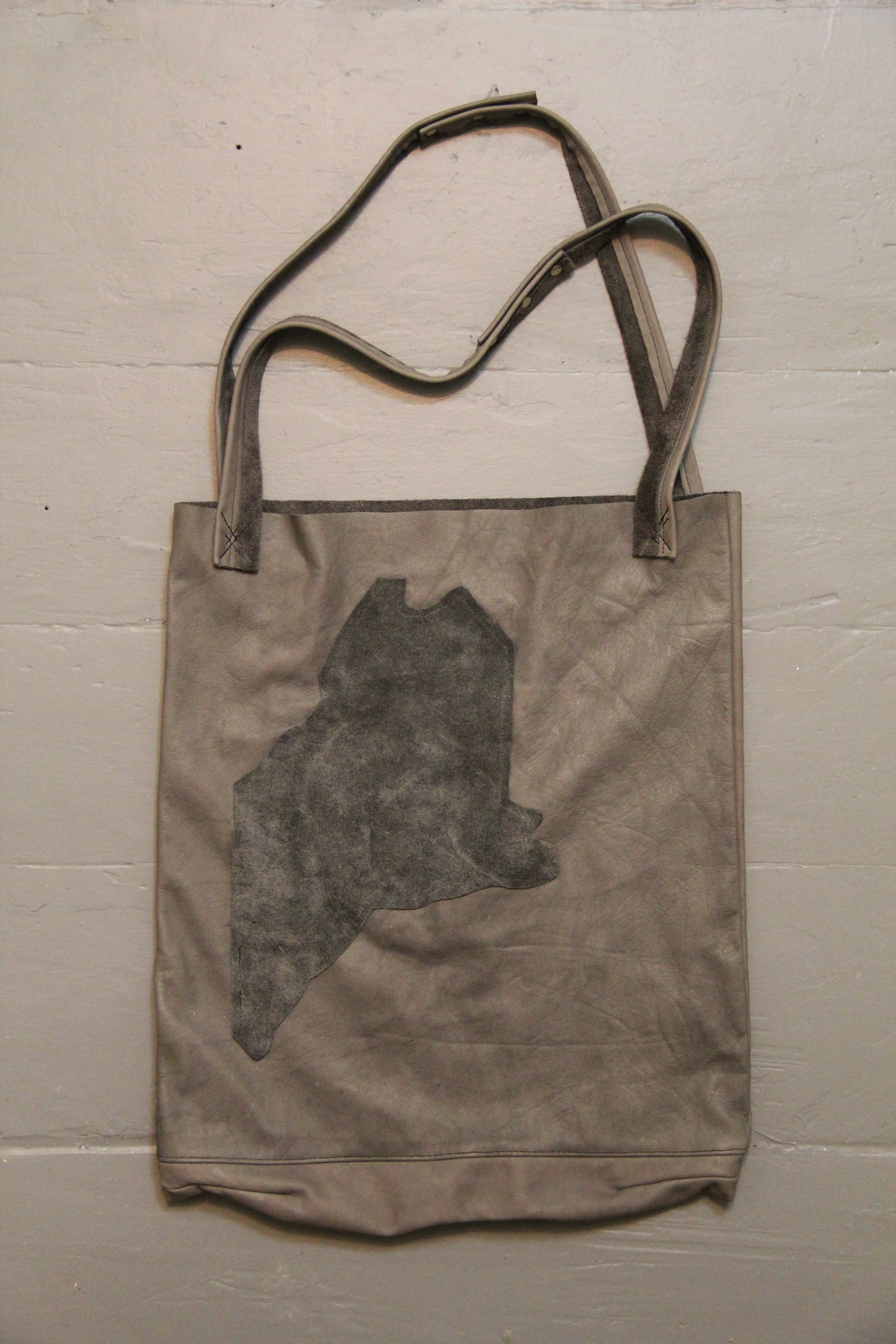pink whiskey grey bag